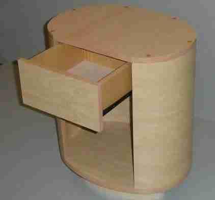 На фото – тумба под телевизор, изготовленная из фанеры.